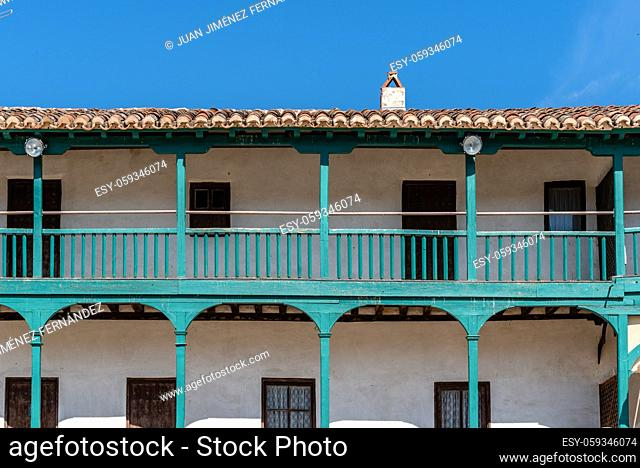 Plaza Mayor of Chinchon. Central square of the town of Chinchon in Madrid, typical houses with wooden balconies and galleries. Sunny day of summer