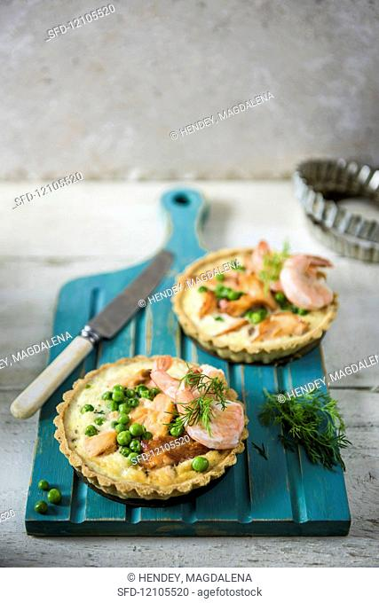 Savoury salmon and prawn tartlets with dill and peas