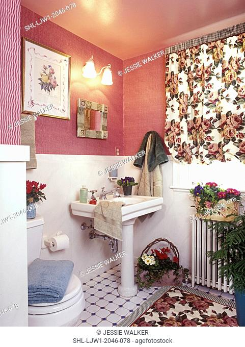 BATHROOMS: Pink moire look wallpaper. Full view. Floral fabric window valance, radiator with basket of plants, pedestal sink, pink painted ceiling, white dado