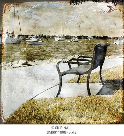 An empty park bench on the bay in Sarasota, Florida