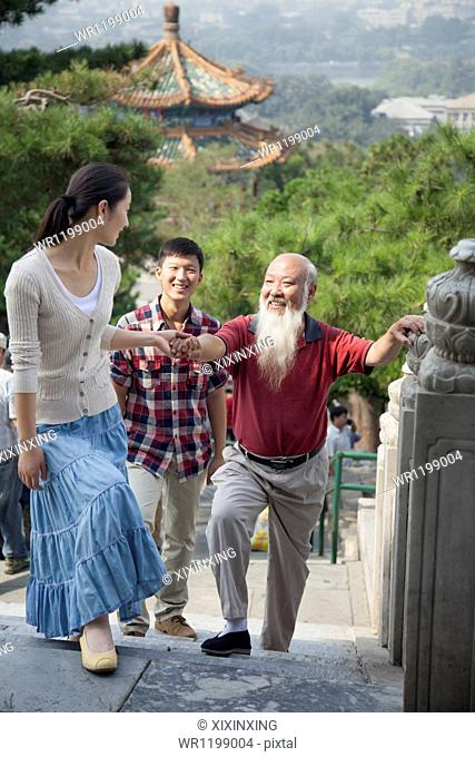 Chinese Family Walking In Jing Shan Park