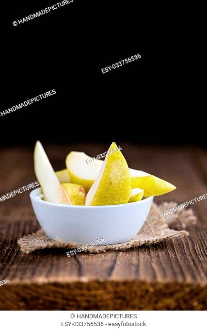 Pears (selective focus) on an old wooden table (close-up shot)