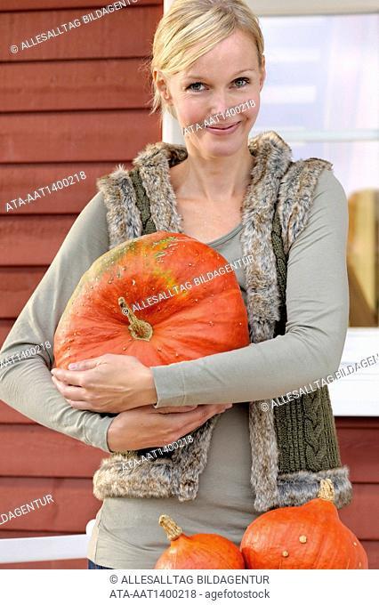 Woman with Hokkaido pumpkins