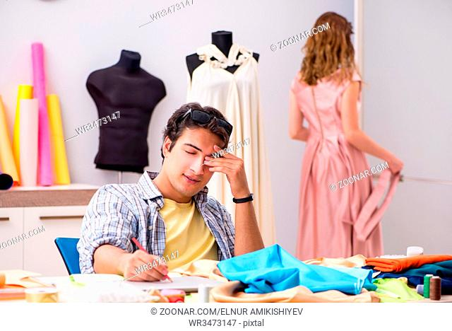 Young tailor working in his workshop