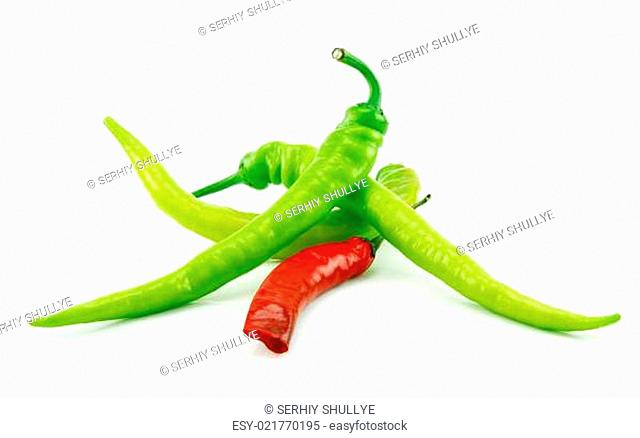 Green and Red Chili Peppers Isolated on White