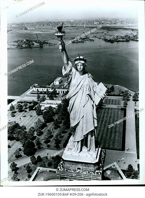 1968 - Chains unshackled at her feet, the Statue of Liberty hold aloft the torch that has lit the way for millions of immigrants to begin new lives