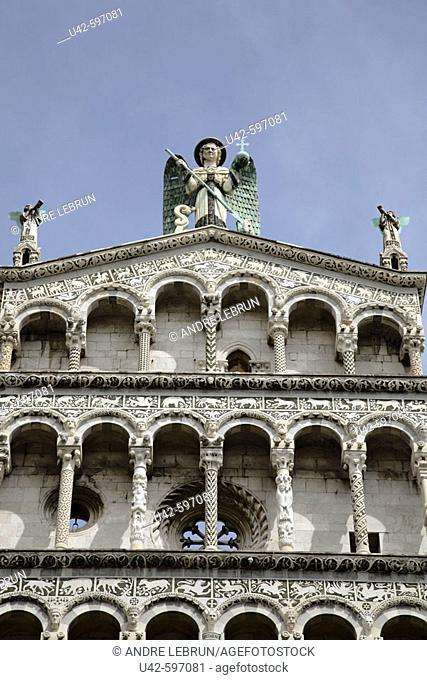 Upper section of Lucca's Chiesa di San Michele in Foro depicting a figure of the Archangel Michael. 2006. Lucca. Tuscany. Italy