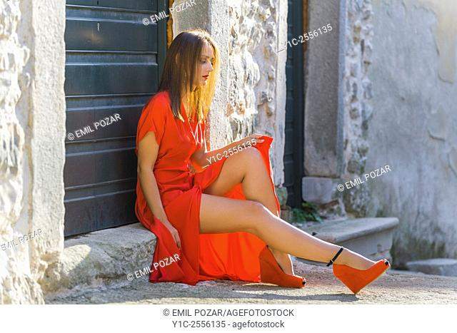 long Red dress and legs exposed