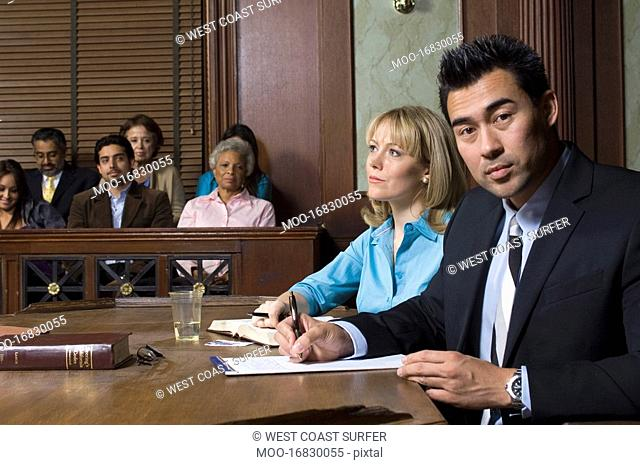 Defense lawyer with client in court