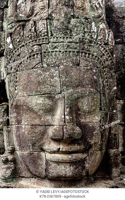 Buddha face carved in stone at the Bayon Temple, Angkor Thom, Angkor, Cambodia