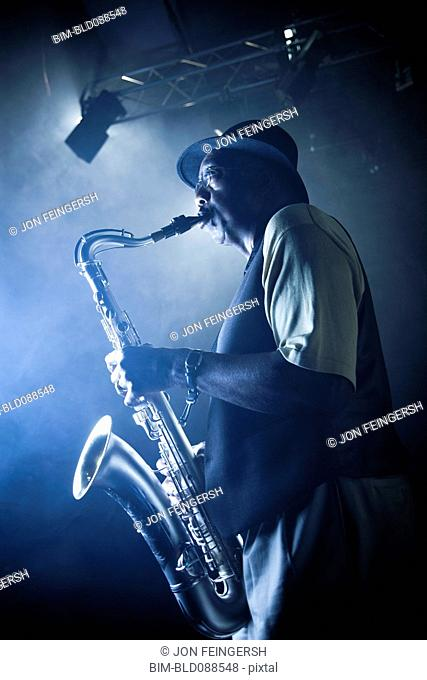 African American musician playing saxophone on stage