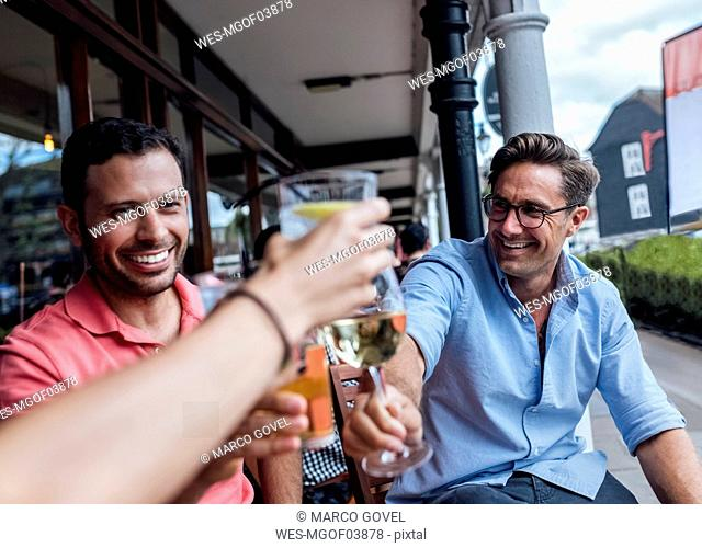 Group of friends having fun and toasting on a terrace