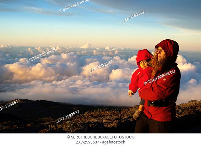 Mother wirh her daughter in Haleakala National Park. Views from the viewpoint of Leleiwi. Maui. Hawaii. Asian tourists enjoy seeing their shadows on the clouds