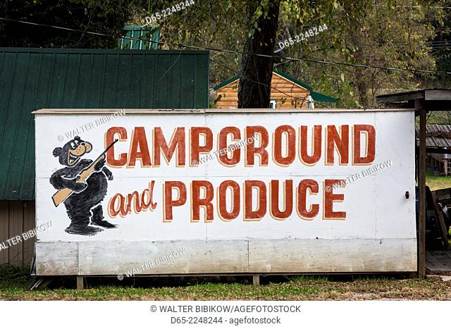 USA, North Carolina, Bryson City, Campground and Produce sign with hunting bear art