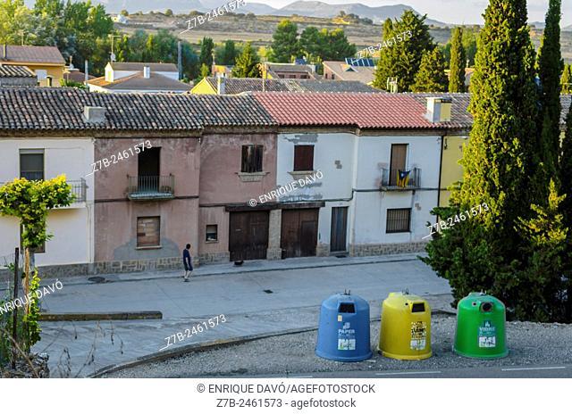 A pedestrian walking by a street of Sentiu of Sio, Lerida province, Catalonia, Spain