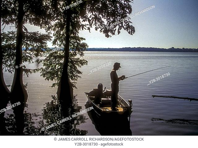 Fisherman in boat at Reelfoot Lake in Tennessee