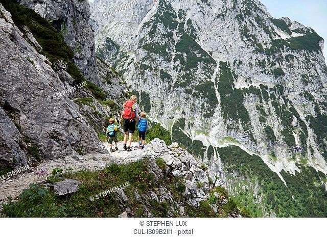 Mother and sons trekking along mountainside, H÷llental, Zugspitze, Garmisch-Partenkirchen, Bavaria, Germany