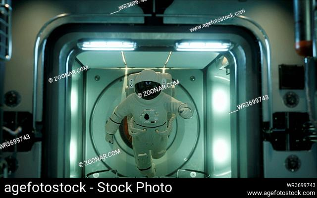 astronaut inside the orbital space station. Elements of this image furnished by NASA