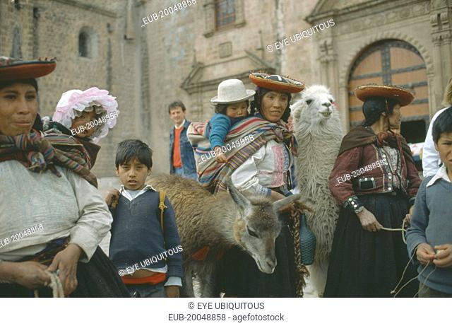 Quechua women and children with lamas
