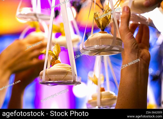 Merengues being put in a lighted design cloud construction as a decor for the presentation of desserts, Strijp-S, Eindhoven, The Netherlands, Europe