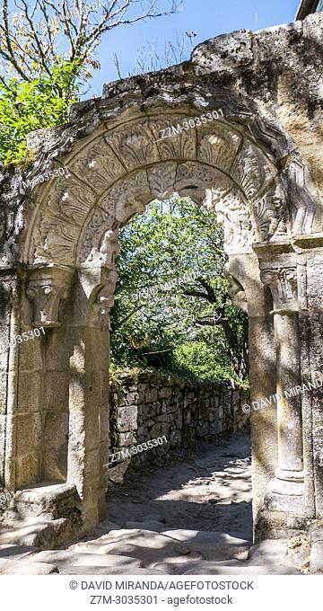 Arch with stone sculptures. Monasterio de Santa Cristina de Ribas de Sil. Ourense. Galicia. Spain