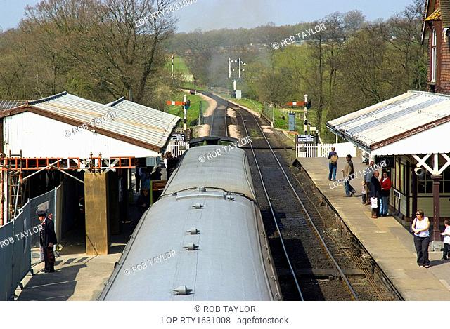 England, East Sussex, Sheffield Park. People boarding a steam train at Sheffield Park Station on the Bluebell Railway