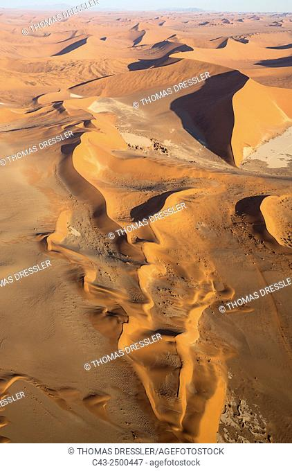 Sand dunes in the Namib Desert. In the evening. Aerial view. Namib-Naukluft National Park, Namibia