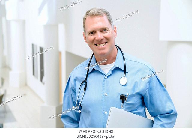 Portrait of smiling Caucasian doctor
