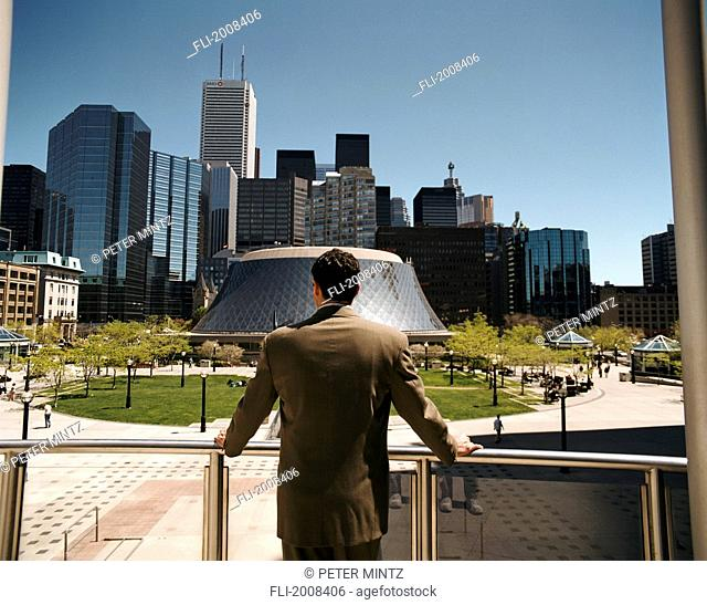 Businessman Looking At City, Toronto, Ontario