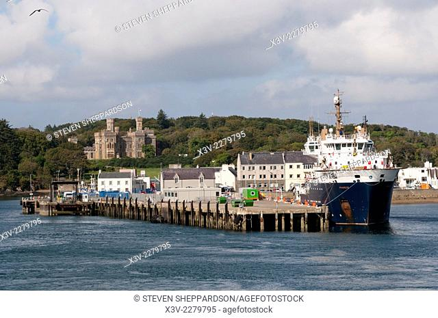 Europe, UK, Scotland, Outer Hebrides, Isle of Lewis - Stornoway Harbour with Lews Castle in background & MV Pharos buoy laying vessel in porrt