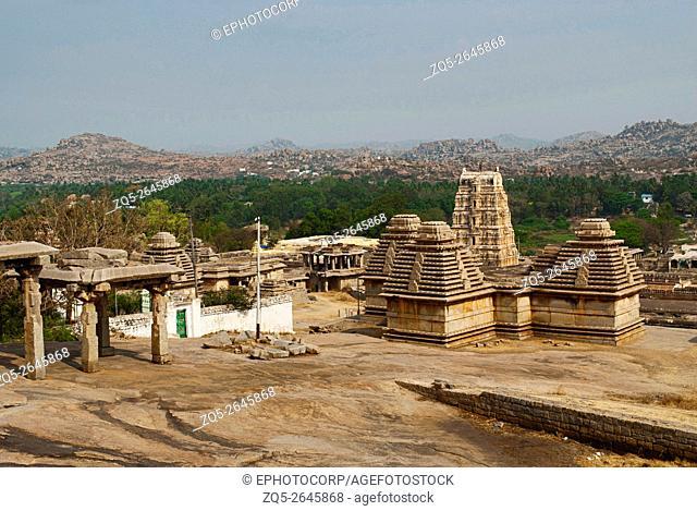 Group of temples, Hemakuta Hill, Hampi, Karnataka, India. Sacred Center. Virupaksha temple gopura is also seen