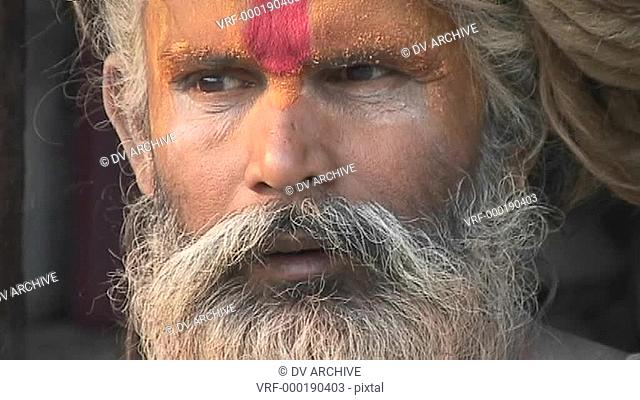 Close up on the face of a Hindu Sadhu - Holy manat Pashupati Temple in Kathmandu