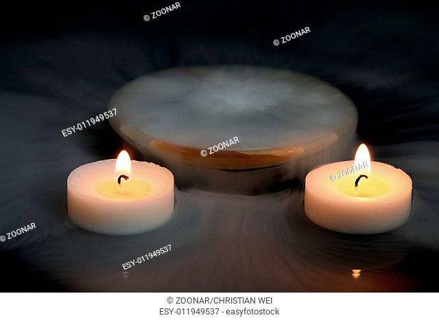 Candles in the mist