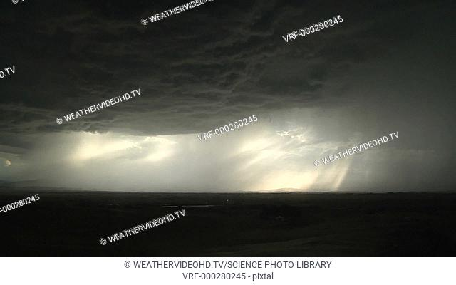 Timelapse footage of the updraft and downdraft regions of a thunderstorm. The downdraft region is marked by a powerful core of rain and sometimes hail