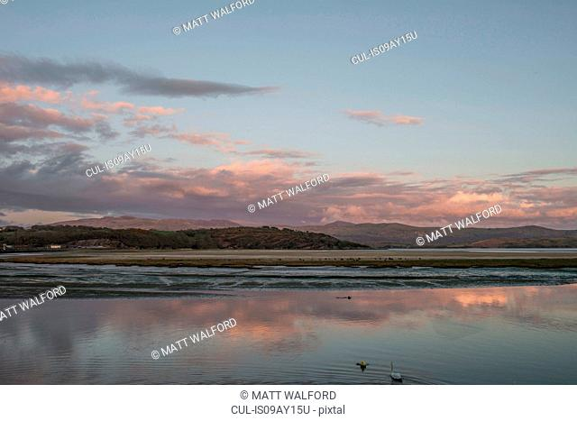 Sea and distant mountains at dawn, Porthmadog, Wales, UK