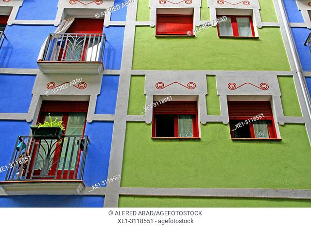 balconies and windows in blue and green walls, Pamplona, Navarra, Spain