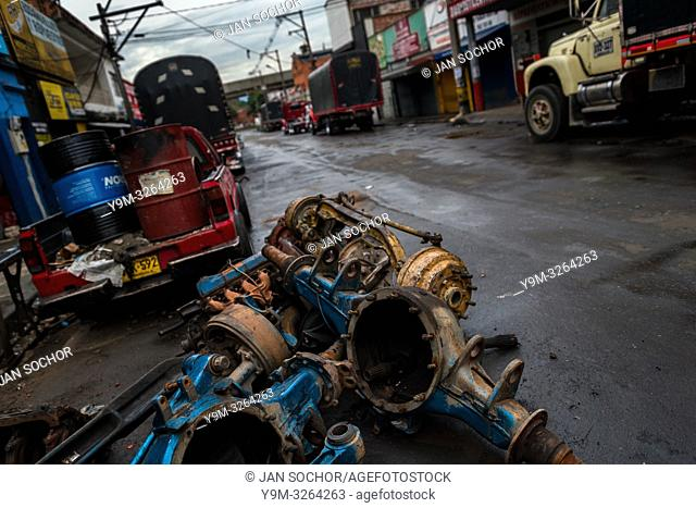 Truck rear axles are seen lying on the street of Barrio Triste, a car mechanics neighborhood in Medellín, Colombia, 9 November 2017