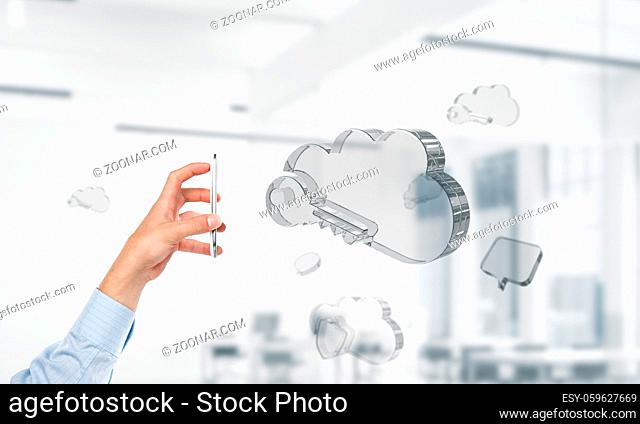 Close of man hand holding mobile phone and glass cloud icon. Mixed media