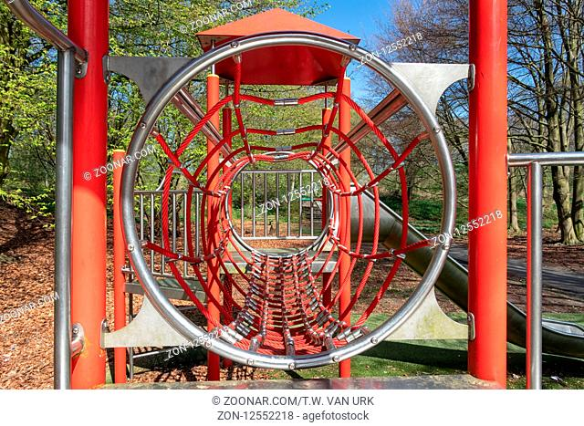 Playground with with rope tunnel and slide in city park Lelystad, The Netherlands