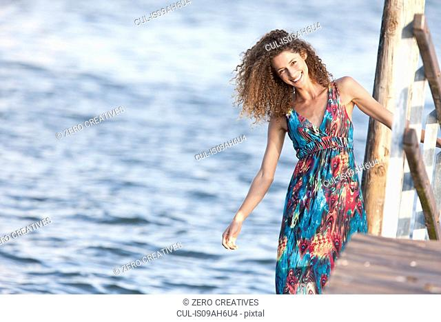 Portrait of young woman on jetty