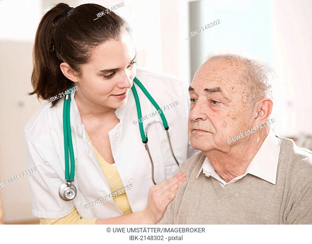 Young doctor taking care of an elderly man