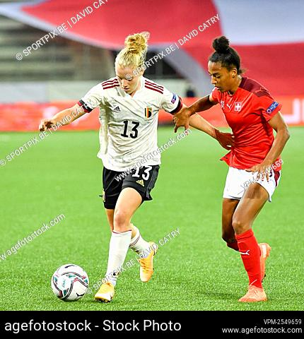 Belgium's Elena Dhont and Switzerland's Eseosa Aigbogun fight for the ball during a soccer game between Switzerland and Belgium's Red Flames
