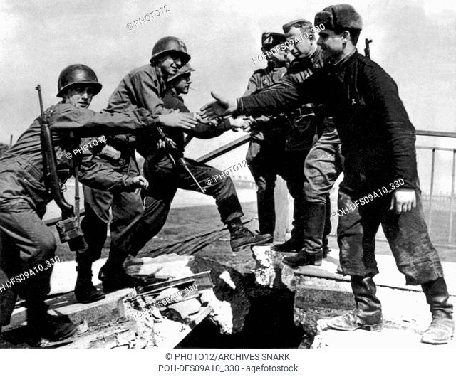 American and Russian soldiers joining on the Elbe bridge, at Torgau  April 1945  Germany