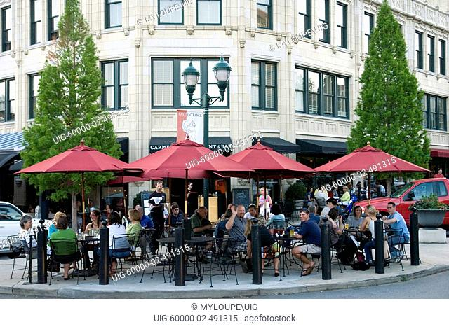 Outdoor cafe and diners on a summer evening in downtown Asheville, North Carolina. Asheville is a city in Buncombe County, North Carolina
