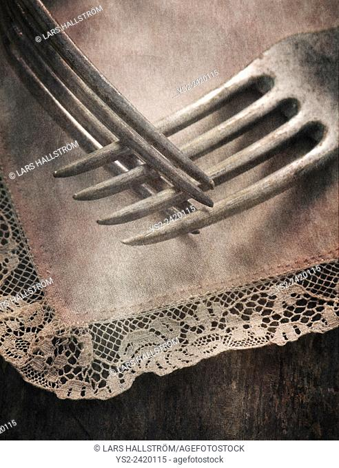Still life with two forks lying on table, close up. Conceptual image of togetherness, love and intimacy