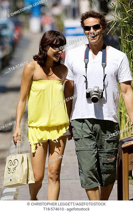 couple walking on sidewalk