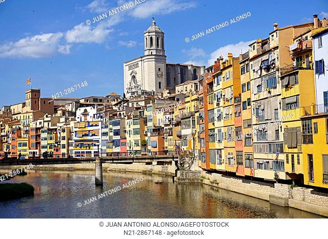 Buildings on the Onyar River. In the background the tower of the cathedral stands out. City of Girona, Catalonia, Spain, Europe