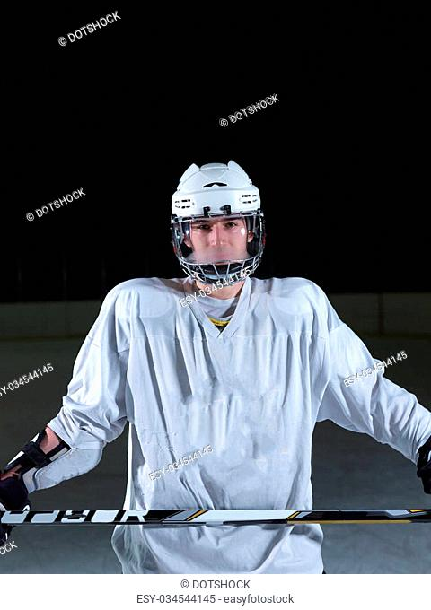young ice hockey player portrait on training in black background