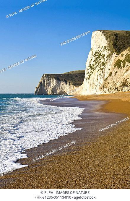 View of chalk cliffs and shingle beach, near Durdle Door, Dorset, England, January
