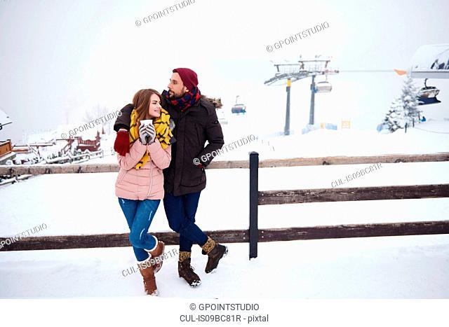 Young couple relaxing by ski resort, Zakopane, Malopolskie, Poland